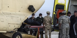 Egyptian paramedics load the corpses of Russian victims of a Russian passenger plane crash in the Sinai Peninsula, into a military plane at Kabret military air base by the Suez Canal on October 31, 2015. Egypt's government said 15 bodies have been recovered and transferred to a morgue so far from the site of the crash.  AFP PHOTO / KHALED DESOUKI        (Photo credit should read KHALED DESOUKI/AFP/Getty Images)